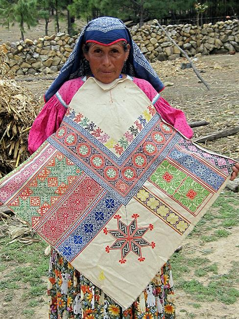Marcella Sandoval and an example of her fine embroidery.
