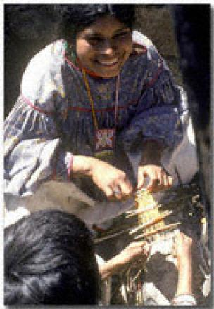 Young Weaving Initiate with Her Offering of a Votive Loom. Photograph: ©Juan Negrín 1980
