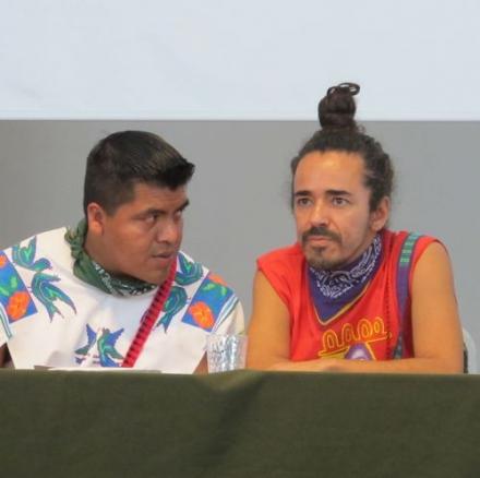 Wixarika leader Santos de la Cruz consults with Ruben Albarran of Café Tacuba in a May 2012 press conference right before Wirikuta Fest. Photo ©Tracy Barnett